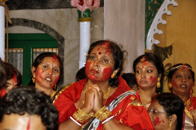The modern day Durga praying to the Goddess.